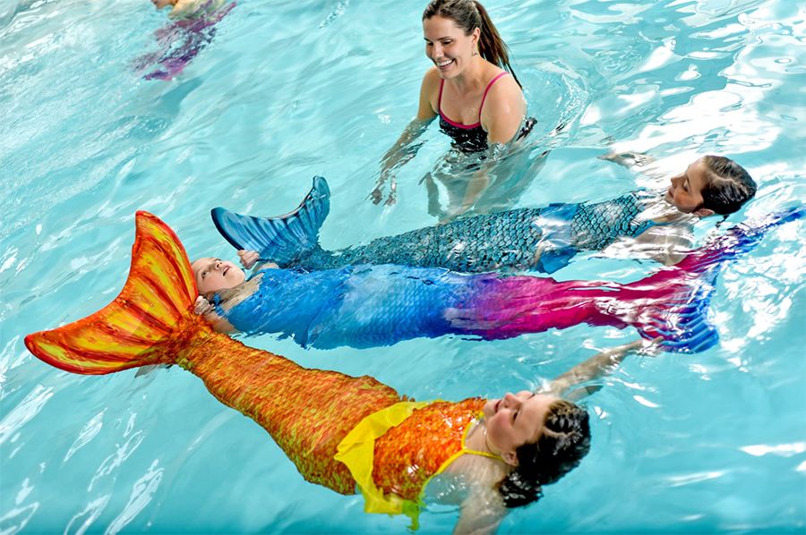girls learning swimming skills in their Fin Fun mermaid tails