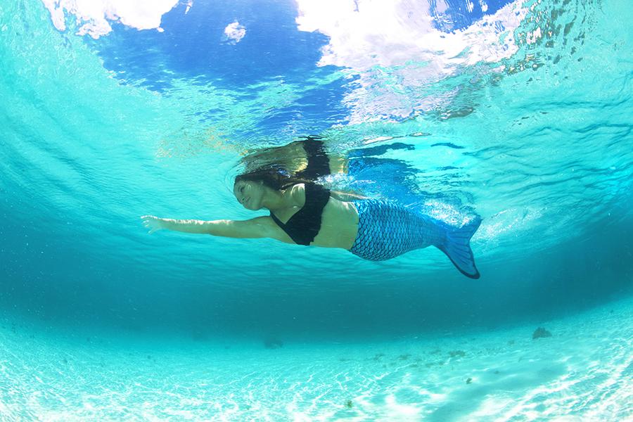 a mermaid in the tidal teal mermaid tail swimming in the ocean