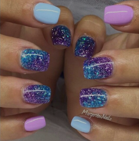 blue, purple, and glitter nail polish are the perfect mermaid nails to match Fin Fun's galaxy mermaid tail
