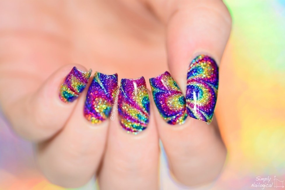 glitter nails on a colorful background