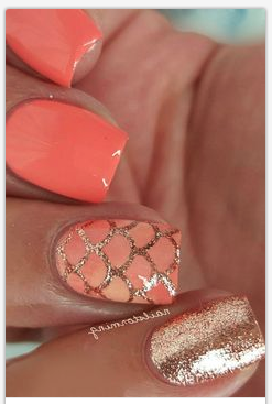 coral nails with gold glitter nails that match the coral cloud mermaid tail