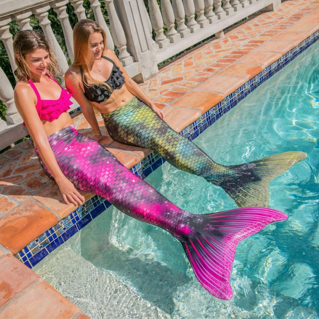 two girls in the Fin Fun Andromeda and Nebula Limited Edition mermaid tails