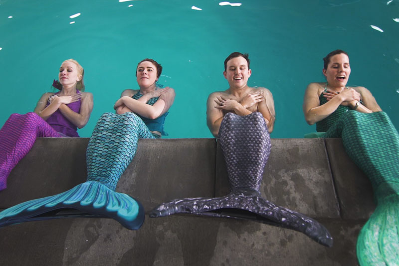 mermaid sit ups on the edge of the pool