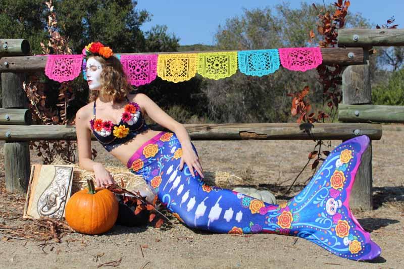 a girl dressed as a mermaid in the Fin Fun Sea Spirits mermaid tail