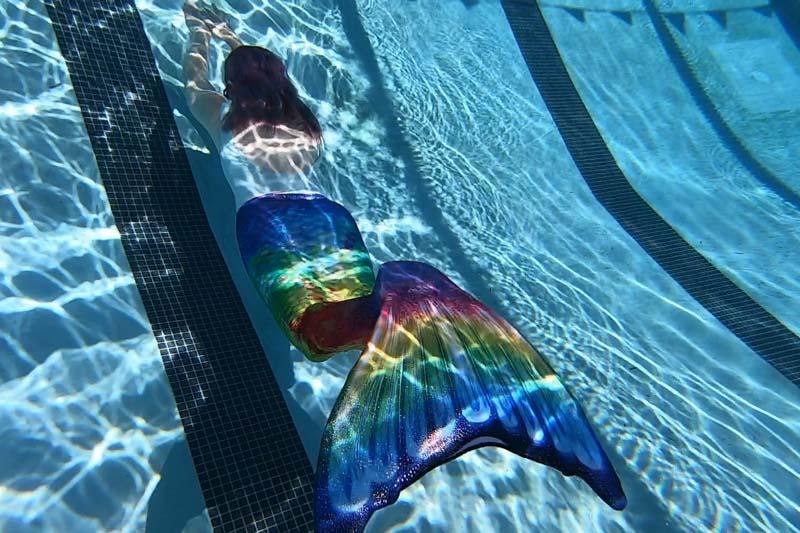 Molly swimming in a Fin Fun mermaid tail at a Mermaid U class.