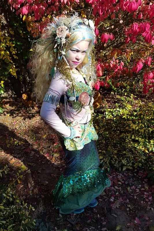 a girl in an intricate mermaid costume