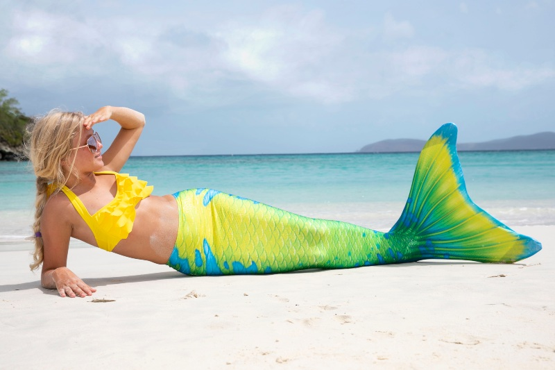 A girl in a bright yellow, green, and blue mermaid tail. It'll make St. Patrick's Day feel like summer!