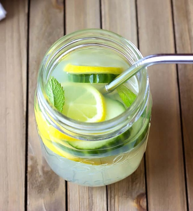 cucumber mint lemonade in a glass jar with a metal straw