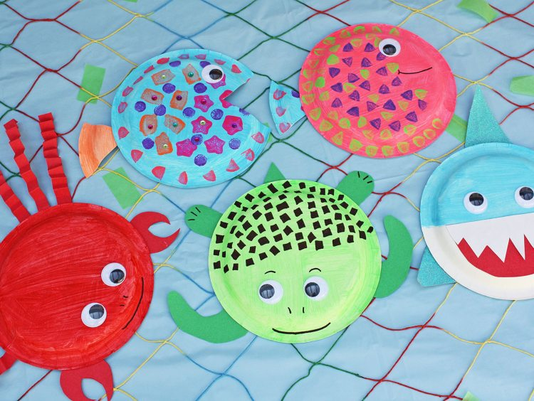 sea creature paper plate crafts, including a crab, turtle, shark, and fish