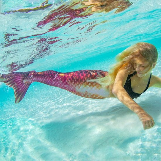girl swimming underwater in the Bronzed Ruby Limited Edition mermaid tail