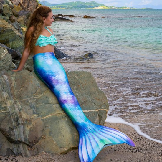 girl on a rock at the beach in the Fin Fun Watercolor Waves Limited Edition mermaid tail