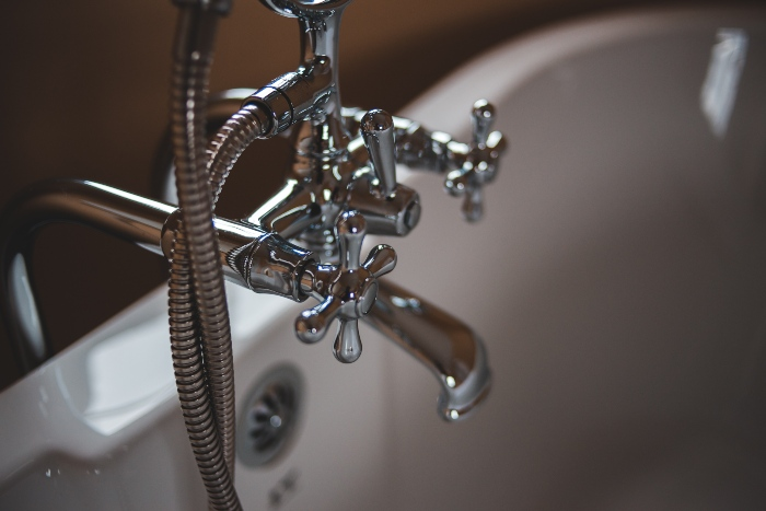 a faucet and pipes