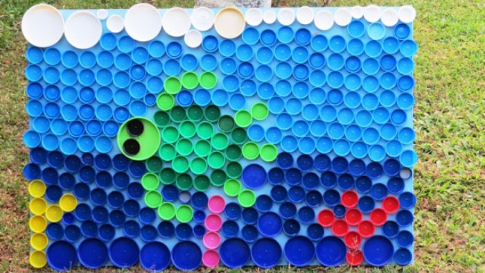 a sea turtle mosaic made with multi-colored plastic bottle caps