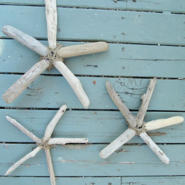 rustic driftwood starfish hang on teal-painted wood