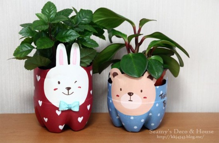 two plant pot plastic bottle crafts that have been painted to resemble a bunny and a bear